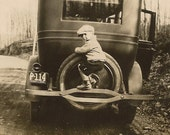 Little Boy On Tire Black and White Snapshot 1924