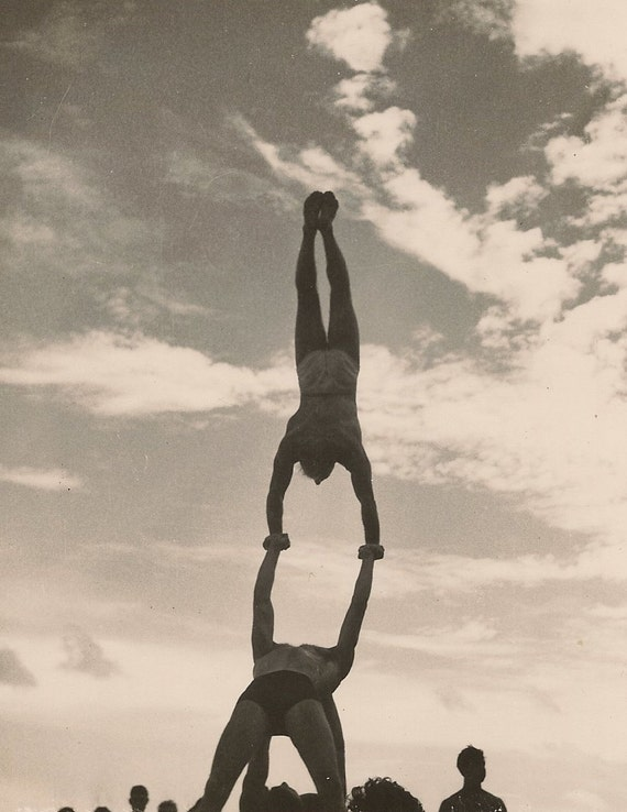 Black and White Vintage Snapshot Handstand In the Clouds