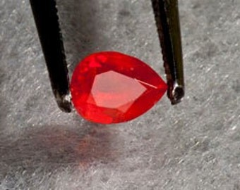 Ruby Vivid Red .61 carat pear AAA Color