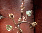 Grapevine Tendril Necklace with green leaves