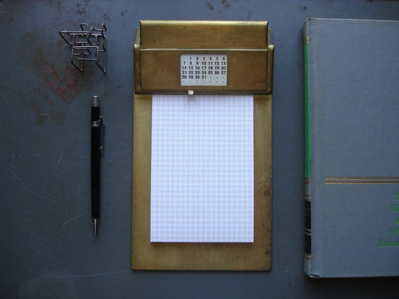 vintage metal clipboard with perpetual calendar