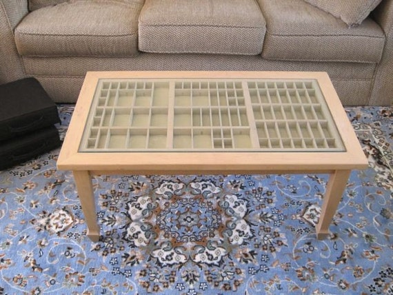 wood coffee table with a printer's type tray in which you