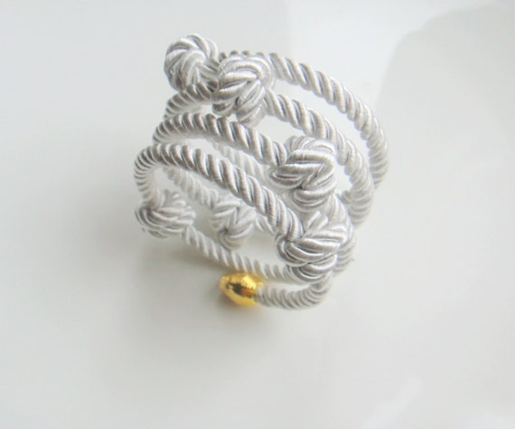 Twisted cord white wrapped around memory wire nautical bracelet with knots