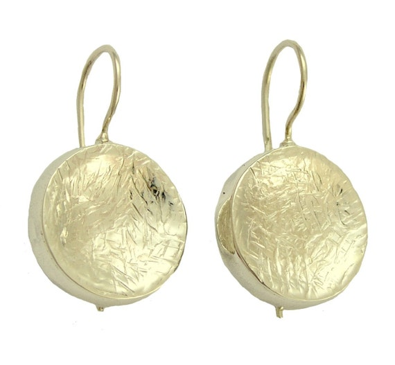 After thought - Sterling silver hammered earrings.