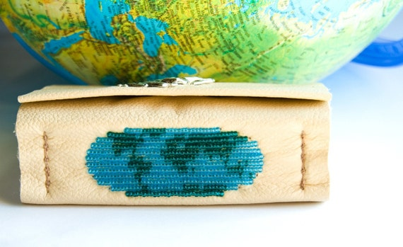 Handbound blank book with beige leather, beaded world / earth image spine and a horse charm on closure