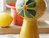 Funky 1970s candleholder from Italy. Retro, earthenware, yellow, green, orange, floral.