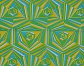Yardage of cotton fabric in brilliant op art kaleidoscope pattern. Retro, aqua, green, yellow, white, groovy.