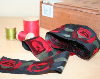 Vintage 1980s ribbon or trim with red roses on black background. Floral, wide, luscious.