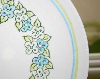 Set of 1960's cereal bowls and bread plates in lettuce green and light blue floral pattern. Spring, Easter, breakfast, aqua.