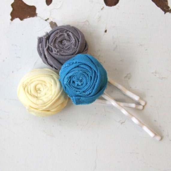 Set of three cotton rosette bobby pins in grey, yellow and turquoise