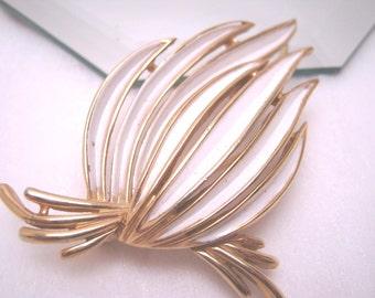 Trifari brooch, 1970s, white enamel and gold-tone metal