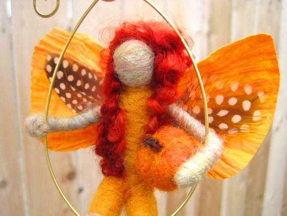 Harvest Fairy w paper, feather wings and little pumpkin, Original design by Borbala Arvai