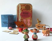 Toy set in a tin, pocket size amusement kit for kids, with vintage Sevi figures, wooden game pieces, and other random items