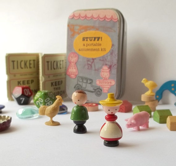 Toy set in a tin, pocket size amusement kit for kids, with vintage Sevi figures, wood Monopoly houses, and other random items
