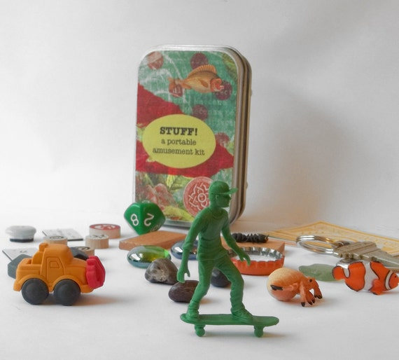 Toy set in a tin, skateboarding dude with random and vintage items, a travel game kit for quiet imaginative play