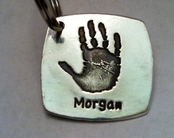 Your Child's Actual Handprint  in Silver  with a name on front Made from your child's actual prints