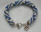 Bracelet- bead crochet rope with sterling silver toggle  clasp and flower charm