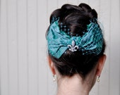Girls or women teal blue bow with rhinestone fleur de lis--French ballerina .  Large holiday bow on a comb.