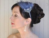Victorian grey feather fascinator headband with elegant rhinestone piece.. A chic classic.