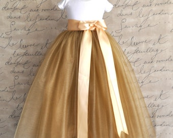 Flower Girl tutu in antique gold tulle sashed with golden satin ribbon lined with champagne satin.