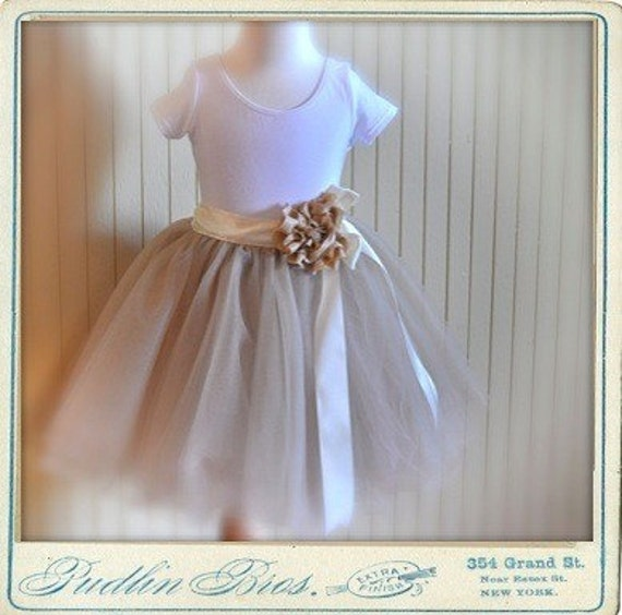 Champagne fluffy tutu with satin ribboned waist. Featured in Martha Stewart Weddings Magazine Spring 2011.