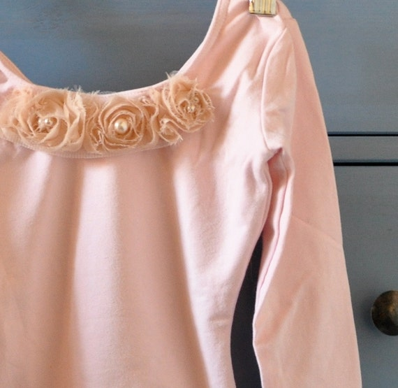 Girls long sleeved plain lined leotard. Blush pink or white. Blossoms available upon request.