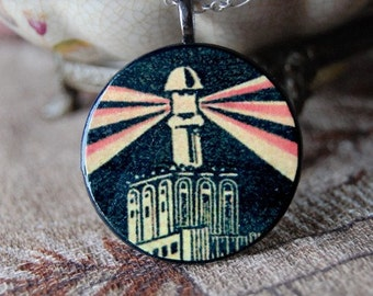 Bright Lights Necklace with Handmade Round Wood Pendant with Vintage Illustration of Night City Skyscraper and Light Beam.