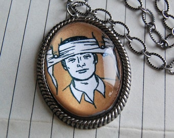 Headache Necklace with Oval Clear Bubble Cameo Pendant with Vintage Illustration of First Aid Man.