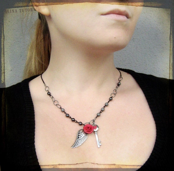 Angel wing  necklace with skeleton key and a rose