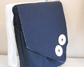 Tall laptop messenger bag in navy blue and white with big buttons. Long strap