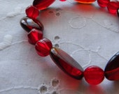Red stretchy bracelet red glass beads