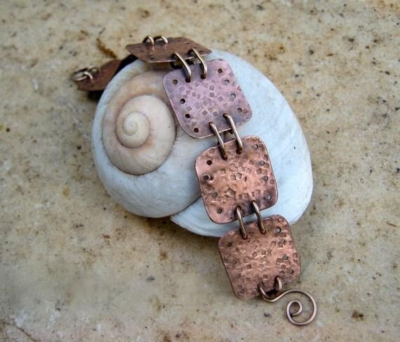 copper metal work bracelet with bronze wire