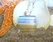 Live Laugh Love written in the sand beach glass necklace/pendant. A unique inspirational gift.