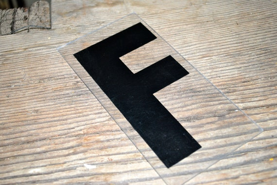 Vintage plastic letter F clear and black