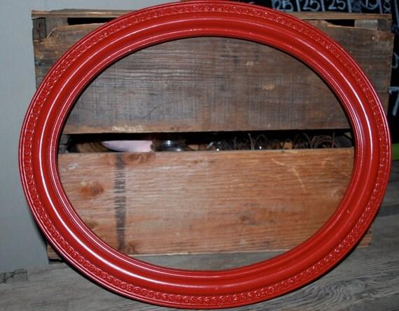 Vintage red plastic oval frame