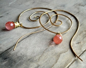 gold plated twisted earrings with pink quartz drops