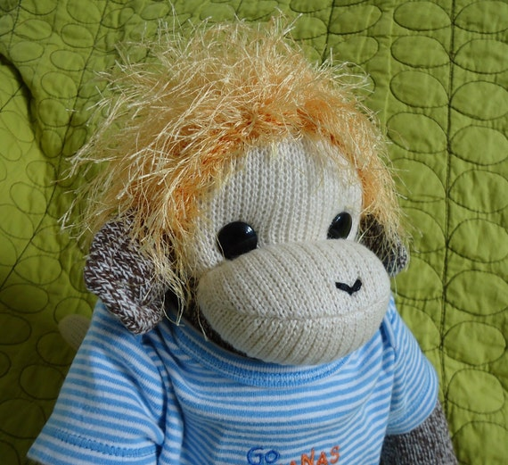 Baby Sock Monkey Lucas, a beautiful one of a kind sock monkey with fingers.  Made by hand in the USA.