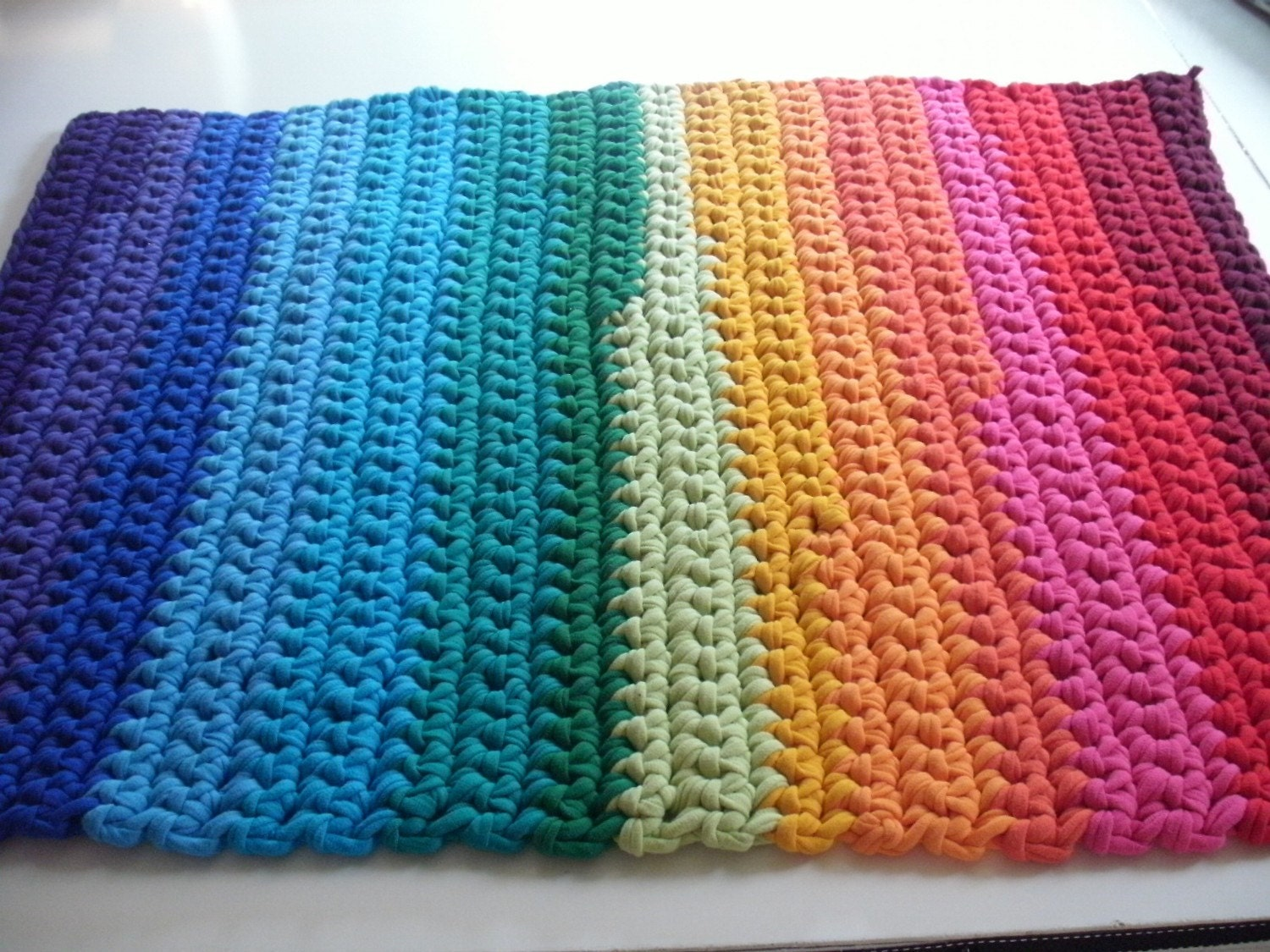 rainbow crochet rug made from recycled t shirt by greenatheartrugs