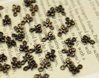 whole shop now with prices 50% off - 100 pcs - antique brass - cute little tiny charm connectors - 5 x 8mm