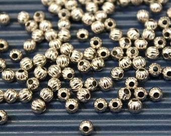 whole shop now with prices 50% off - 200 pcs - Silver Metallic Beads - 5mm Spacer Beads