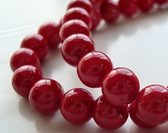 Fossil Beads 6mm Natural Tomato Red Smooth Round - 8 inch Strand