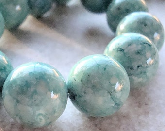 Fossil Beads 12mm Natural Mint Green Smooth Rounds - 12 Pieces