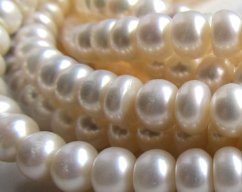 Pearl Beads 6 x 4mm Lustrous Snow White Freshwater Rondelles - 8 inch Strand