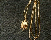Gold plated sea turtle necklace