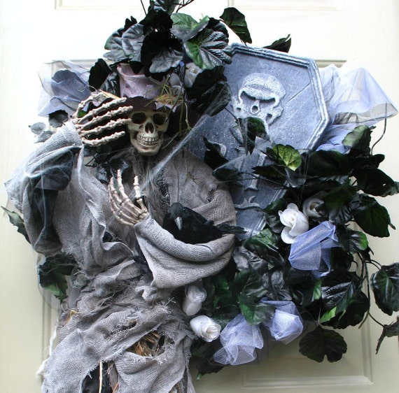 A Bird in the Hand is Worth Two in the Skulls Tombstone Delight with Light Up Head Halloween Wreath by English Rose Deisgns