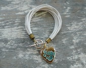 Almighty Aphrodite Bracelet in White Leather with Turquoise Enameled Heart Charm