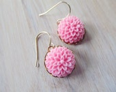 Pink floral earrings on gold bezels