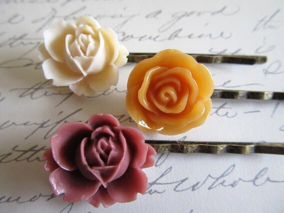 Floral hair pins in neutral tones of cream, pumpkin and burgundy