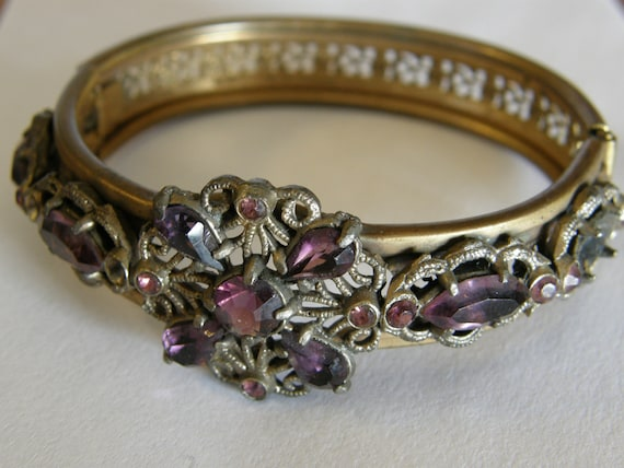 Antique Victorian or Edwardian gilt filigree hinged bangle with amethyst glass stones