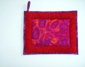 """Oversized Quilted Pot Holder / Hot Pad -- Red, Pink and Orange """"Amoeba"""" Fabric with Red Borders"""